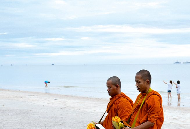 Monks receive provisions on the beach outside InterContinental Hua Hin | Belinda Craigie