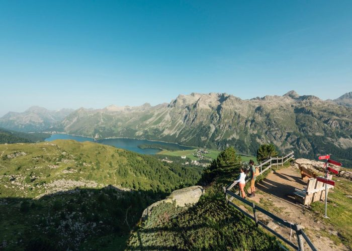 Furtschellas viewpoint with Edelweiss bench and views of Lake Sils.