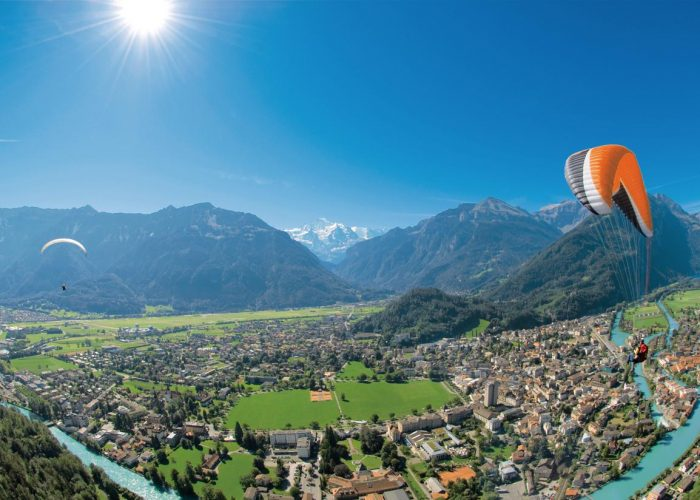 Paraglider flying over Interlaken
